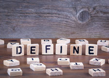 Define from wooden letters on wooden background stock photography