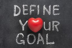 Define your goal heart. Define your goal phrase handwritten on blackboard with heart symbol instead of O Royalty Free Stock Photography