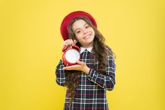 Define your own rhythm of life. Happy hours concept. Schedule and timing. Girl with alarm clock. Set up alarm clock. Child little girl hold red clock. It is royalty free stock images