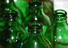 Defined green bottles. First bottle is strong and then fades out Stock Image