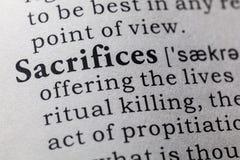 Definición de sacrificios imagenes de archivo