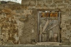 How to Define Old Doors. Walking along the streets of Favignana, Sicily; I found myself wondering just how long a door can survive when I found myself in front royalty free stock image