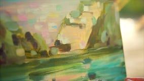 Definitieve aanrakingen van impressionist die Engelse pleinlucht schilderen stock videobeelden