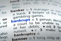 Definition of Bankrupt. The word Bankrupt in a dictionary, word in blue with rest of page text in black Stock Photography