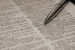 Definition of business. Word business in dictionary highlighted by pen Royalty Free Stock Photo