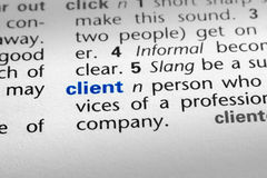 Definition of Client. The word Client in a dictionary, word in blue with rest of page text in black Stock Photo