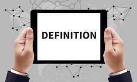 DEFINITION CONCEPT. On the tablet pc screen by businessman hands, top view stock photography