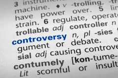 Definition of Controversy. The word Controversy in a dictionary, word in blue with rest of page text in black Royalty Free Stock Photos