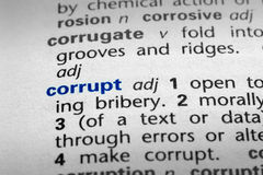 Definition of Corrupt. The word Corrupt in a dictionary, word in blue with rest of page text in black Stock Image