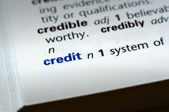 Definition of Credit. The word Credit in a dictionary, word in blue with rest of page text in black Stock Photo