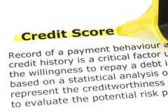 Credit Score highlighted in yellow. Definition of Credit Score highlighted in yellow with felt tip pen royalty free stock photo