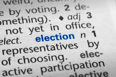 Definition of Election. The word Election in a dictionary, word in blue with rest of page text in black Stock Photo