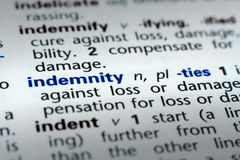 Definition of Indemnity. The word Indemnity in a dictionary, word in blue with rest of page text in black Stock Image