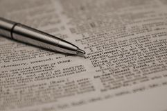 Definition of investment. Word investment in dictionary highlighted by pen Royalty Free Stock Photos
