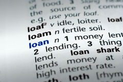 Definition of Loan. The word Loan in a dictionary, word in blue with text in black Royalty Free Stock Photos