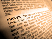 Definition of Profit. In dictionary book on pages with type Stock Images