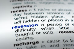 Definition of Recession. The word Recession in a dictionary, word in blue with rest of page text in black royalty free stock image