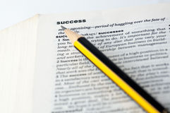 Definition of success. In a dictionary with a pencil on it Royalty Free Stock Photos