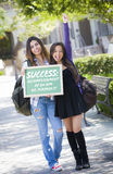 Definition of Success Female Students with Chalkboard Stock Photography