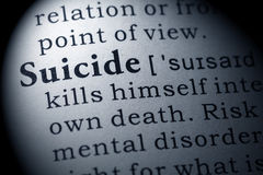 Definition of suicide. Fake Dictionary, Dictionary definition of the word suicide. including key descriptive words stock image
