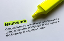 Definition of teamwork, highlighted in colour. Stock Image