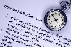 Definition of Time and Pocket Watch. Pocket watch and definition of time, concept analogy for aspects of time Stock Photo