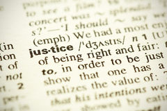 Definition of the word Justice. Dictionary definition of the word Justice in English. Shallow DOF Stock Photo