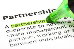 Definition Of The Word Partnership. The word Partnership highlighted in green with text marker Stock Photos