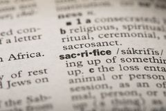 Closeup of the word `Sacrifice` in a dictionary. Definition of the word `Sacrifice` in a dictionary stock images