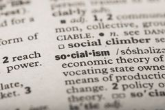 Closeup of the word `Socialism` in a dictionary. Definition of the word `Socialism` in a dictionary stock photo