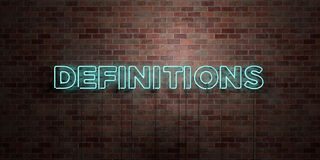 DEFINITIONS - fluorescent Neon tube Sign on brickwork - Front view - 3D rendered royalty free stock picture Stock Photo