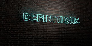 DEFINITIONS -Realistic Neon Sign on Brick Wall background - 3D rendered royalty free stock image Stock Photos