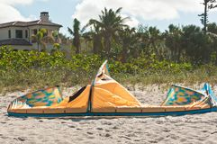 Deflated canopy for kiteboard in sand of a tropical beach. Extreme sport,deflated canopy for kiteboard on a tropical beach on a stormy, windy, autumn day in the Stock Photo