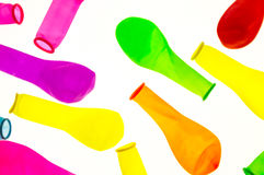 Deflated colored balloons , on white background Stock Image