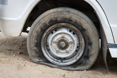 Deflated damaged tyre Stock Images