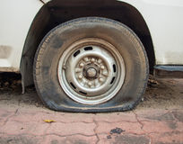 Deflated damaged tyre on car wheel Royalty Free Stock Images