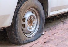 Deflated damaged tyre on car wheel Stock Photography