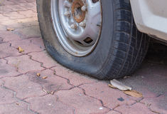 Deflated damaged tyre on car wheel Royalty Free Stock Photography