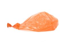 Deflated orange balloon isolated over white Royalty Free Stock Photos