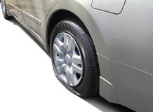 Deflated Tire. Deflated rear, left tire on an automobile Royalty Free Stock Photography