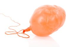 Deflated yellow balloon at a rope;  over white Royalty Free Stock Photography