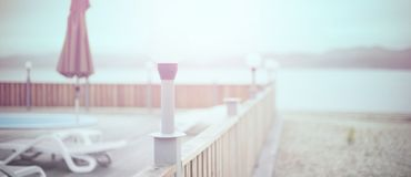 Defocus Banner Wooden deck beach sea ocean resort sun lounger umbrella hotel pool sky sunrise. stock photo