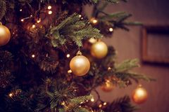 Decorations on a Christmas tree and glare of lights Royalty Free Stock Photos