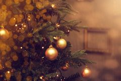 Decorations on a Christmas tree and glare of lights Royalty Free Stock Photography
