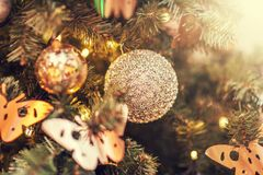 Defocus beautiful decorations on a Christmas tree. Balls, toys and glare of lights Stock Photo