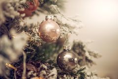 Decorations on a Christmas tree and glare of lights Royalty Free Stock Photo
