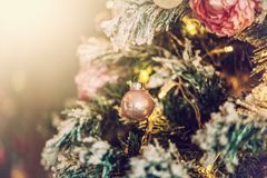 Decorations on a Christmas tree and glare of lights Stock Photos