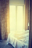 Defocus blur abstract background of bed at window view in bedroom Royalty Free Stock Image