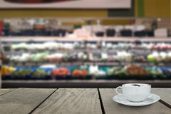 Defocus and blur image of Supermarket blur background with cappu Stock Photography