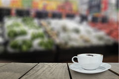 Defocus and blur image of Supermarket blur background with cappu Royalty Free Stock Photo